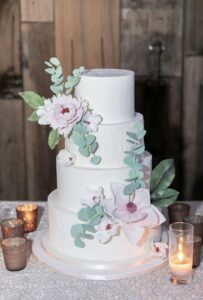 4 tier white wedding cake with sugar flowers